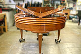 Back of Wurlitzer Butterfly baby grand piano in for restoration